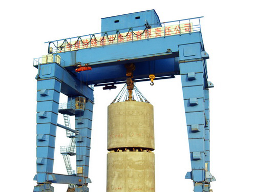 Self-elevating gantry cranes